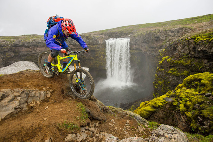 biking next to waterfall