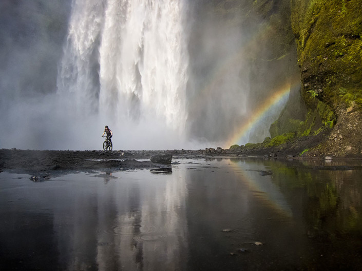 huge waterfall with biker