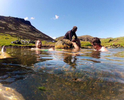 chilling in hot river in iceland